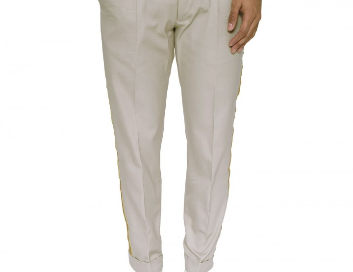 Chino in sand with metal thread applications in gold