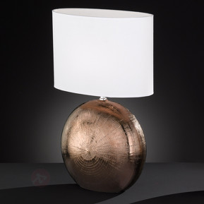 Table lamp with copper colored foot